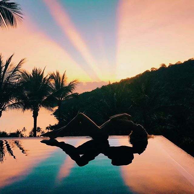 This magical sunrise in Thailand reflecting off of our pool early morning got us all up from bed to take photos 🌅